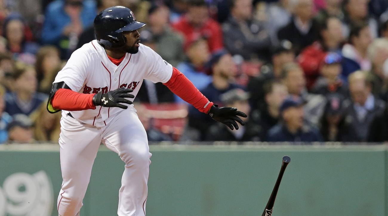Boston Red Sox's Jackie Bradley Jr. tosses the bat after hitting a double during the second inning of a baseball game against the Colorado Rockies in Boston, Tuesday, May 24, 2016. With the hit, Bradley extended his hitting streak to 28 games. (AP Photo/C