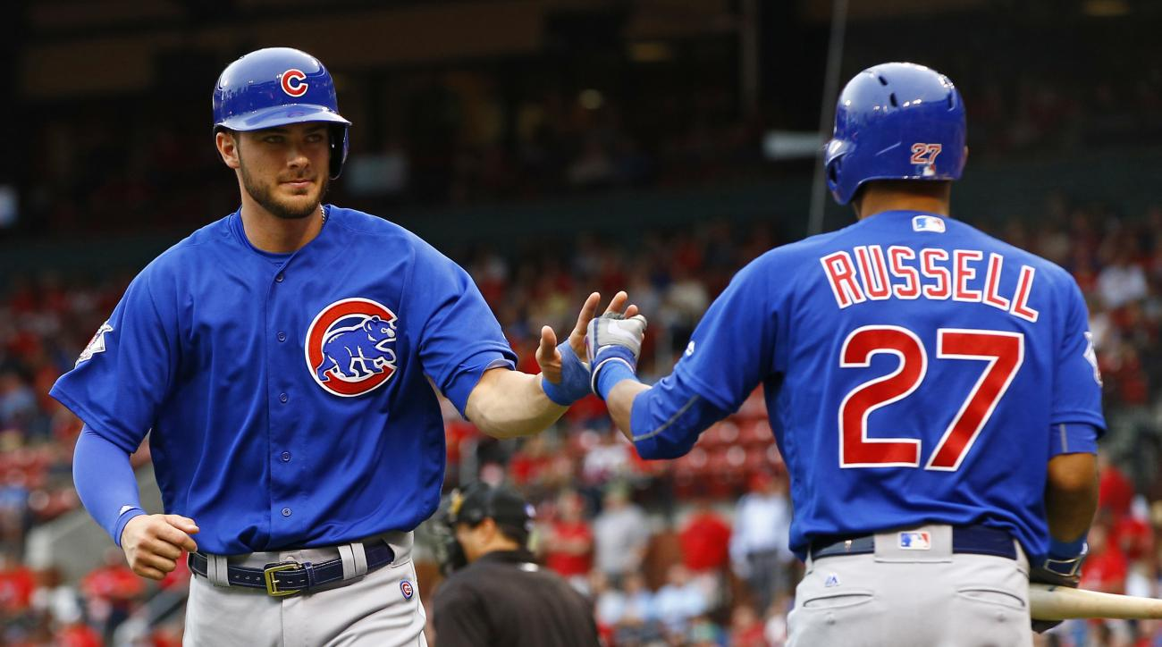 Chicago Cubs' Kris Bryant, left, is congratulated by Addison Russell after scoring on a bases-loaded walk during the first inning of a baseball game, Tuesday, May 24, 2016, in St. Louis. (AP Photo/Billy Hurst)