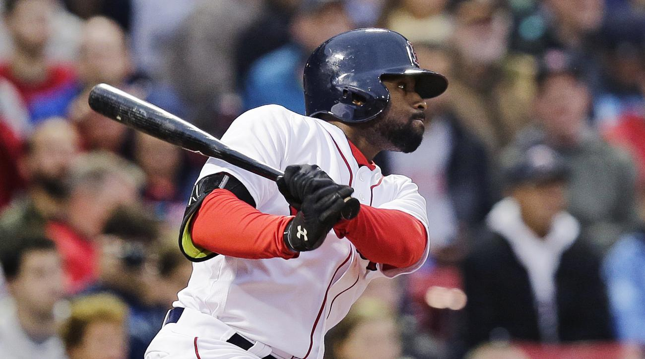 Boston Red Sox's Jackie Bradley Jr. follows through on a double during the second inning of a baseball game against the Colorado Rockies in Boston, Tuesday, May 24, 2016. Bradley extended his hitting streak to 28 games. (AP Photo/Charles Krupa)