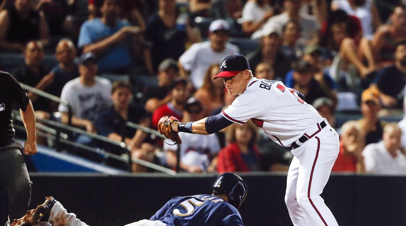 Milwaukee Brewers' Jonathan Villar (5) is tagged out at third by Atlanta Braves third baseman Gordon Beckham (7) on a Ryan Braun ground ball in the sixth inning of baseball game Tuesday, May 24, 2016, in Atlanta. (AP Photo/John Bazemore)