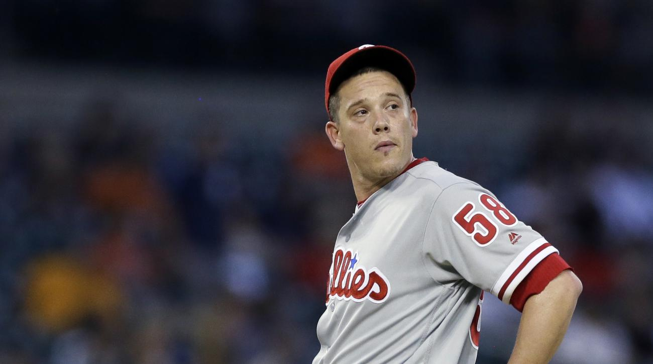 Philadelphia Phillies starting pitcher Jeremy Hellickson looks back from the mound after giving up two runs during the sixth inning of a baseball game against the Detroit Tigers, Tuesday, May 24, 2016, in Detroit. (AP Photo/Carlos Osorio)