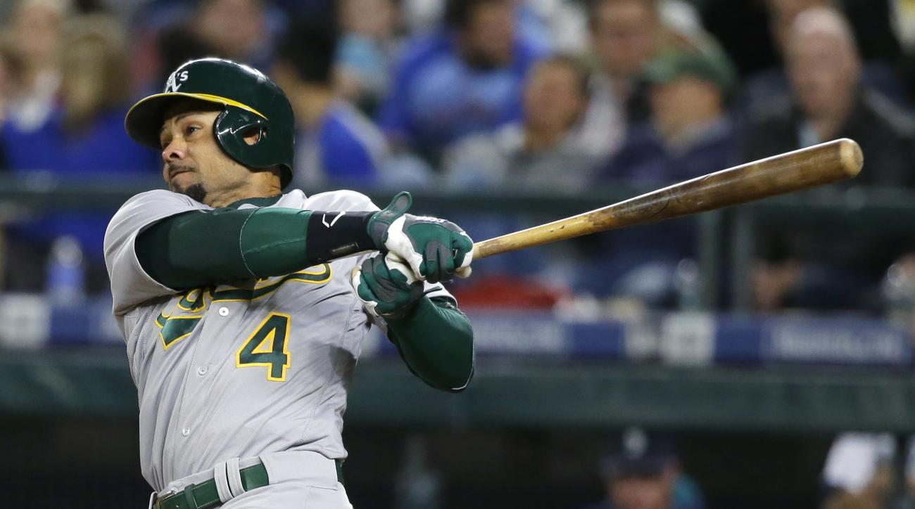 Oakland Athletics' Coco Crisp follows through on a two-run double during the sixth inning of a baseball game against the Seattle Mariners, Tuesday, May 24, 2016, in Seattle. (AP Photo/Ted S. Warren)