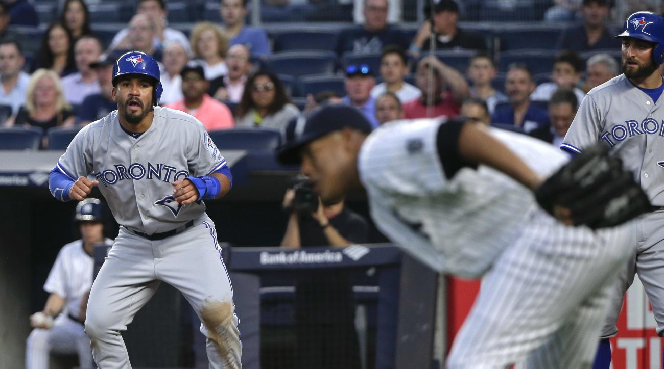 Toronto Blue Jays' Devon Travis reacts after scoring on a double by Ryan Goins against the New York Yankees during the fourth inning of a baseball game Wednesday, May 25, 2016, in New York. (AP Photo/Julie Jacobson)