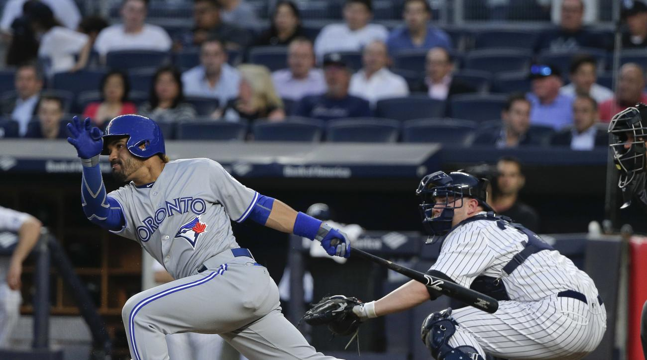 Toronto Blue Jays' Devon Travis follows through on an infield hit against the New York Yankees during the fourth inning of a baseball game Wednesday, May 25, 2016, in New York. (AP Photo/Julie Jacobson)