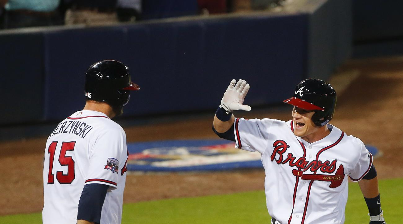 Atlanta Braves pinch-hitter Gordon Beckham celebrates with A.J. Pierzynski (15) after hitting a two-run home run during the sixth inning of a baseball game against the Milwaukee Brewers on Wednesday, May 25, 2016, in Atlanta. (AP Photo/John Bazemore)
