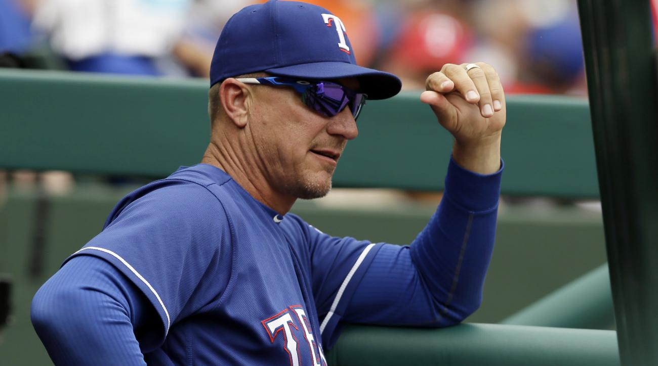 FILE - In this Wednesday, May 25, 2016, file photo, Texas Rangers manager Jeff Banister looks on from the dugout during a baseball game against the Los Angeles Angels in Arlington, Texas. Before leading the Rangers to the AL West title last season in his