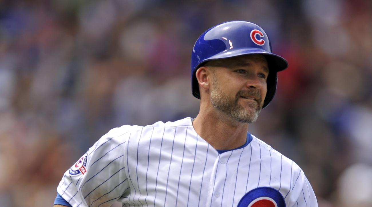 Chicago Cubs' David Ross watches his three-run home run during the fourth inning of a baseball game against the Philadelphia Phillies, Friday, May 27, 2016, in Chicago. (AP Photo/Paul Beaty)