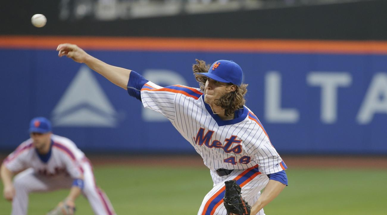 New York Mets' Jacob deGrom delivers a pitch during the first inning of a baseball game against the Los Angeles Dodgers on Friday, May 27, 2016, in New York. (AP Photo/Frank Franklin II)