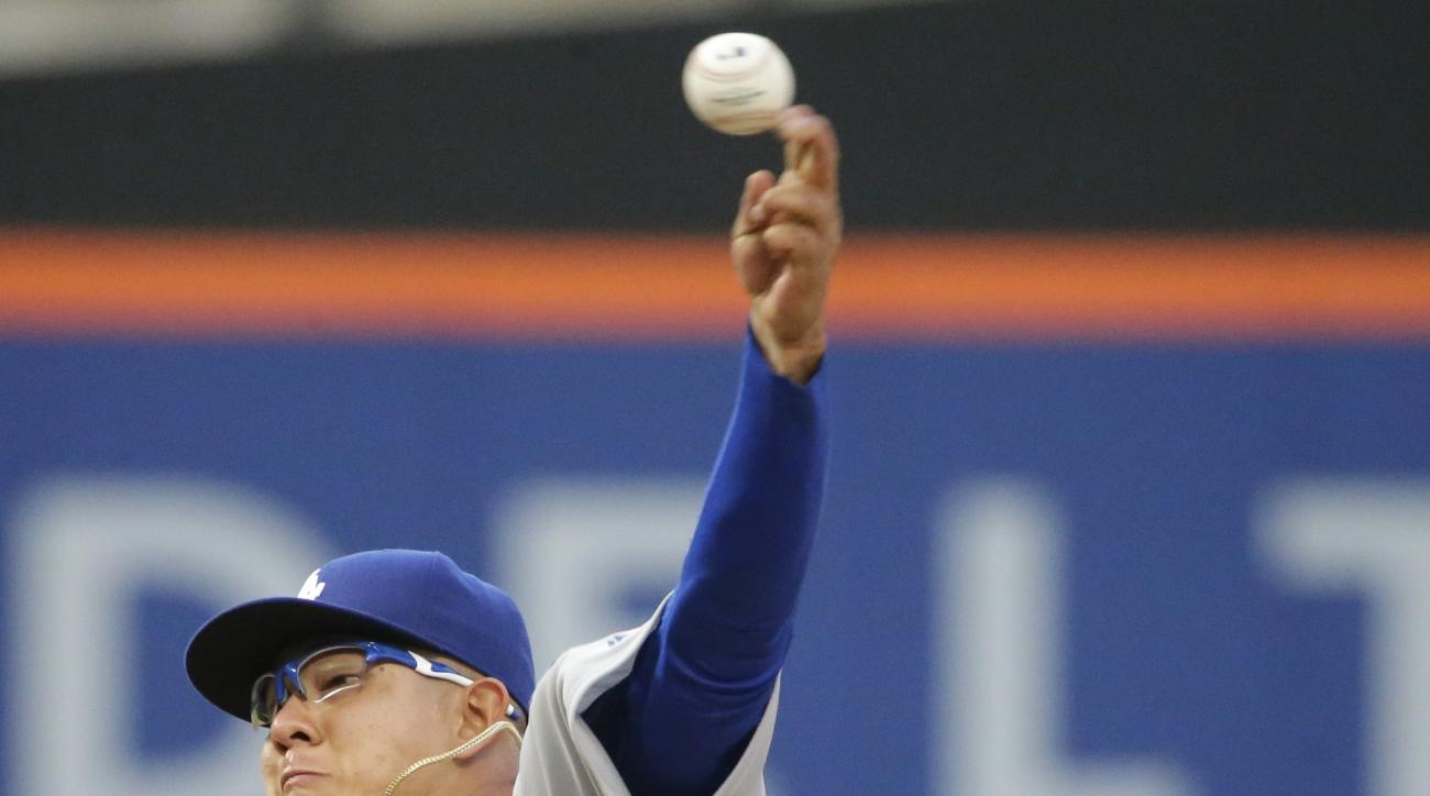 Los Angeles Dodgers Julio Urias delivers a pitch during the first inning of a baseball game against the New York Mets on Friday, May 27, 2016, in New York. (AP Photo/Frank Franklin II)