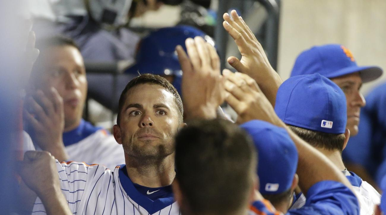 New York Mets' David Wright celebrates with teammates after hitting a home run during the fourth inning of a baseball game against the Los Angeles Dodgers on Friday, May 27, 2016, in New York. (AP Photo/Frank Franklin II)