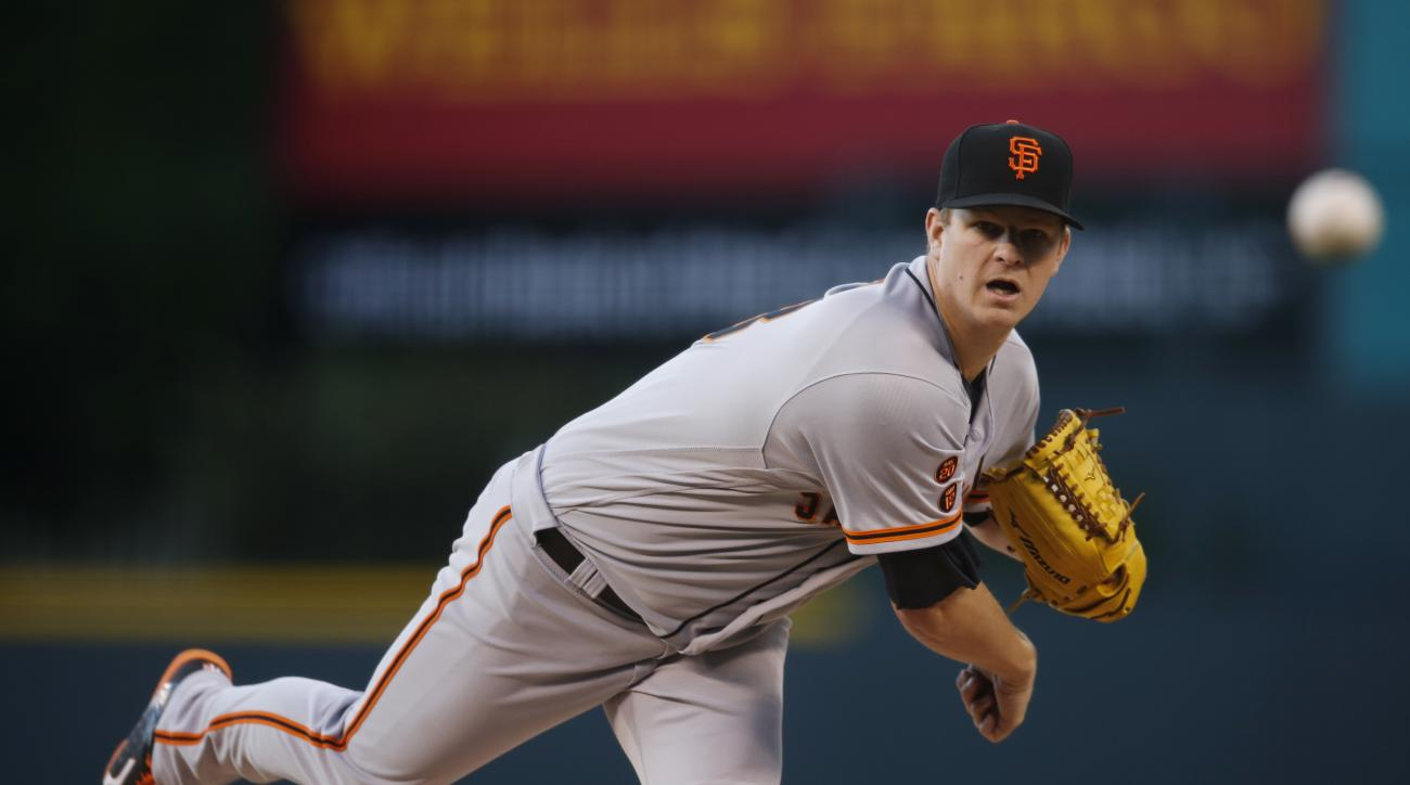 San Francisco Giants starting pitcher Matt Cain works against the Colorado Rockies in the first inning of a baseball game Friday, May 27, 2016, in Denver. (AP Photo/David Zalubowski)