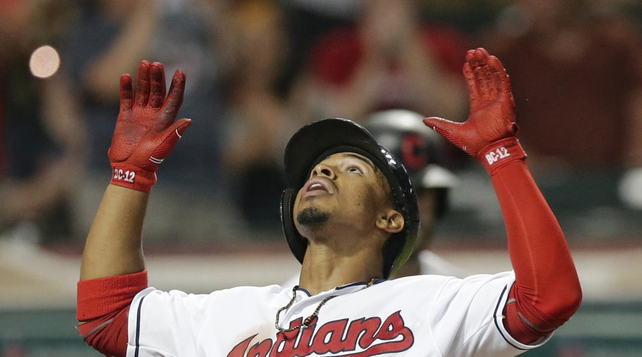 Cleveland Indians' Francisco Lindor looks up as he scores on a solo home run off Baltimore Orioles relief pitcher Darren O'Day during the eighth inning of a baseball game, Friday, May 27, 2016, in Cleveland. (AP Photo/Tony Dejak)
