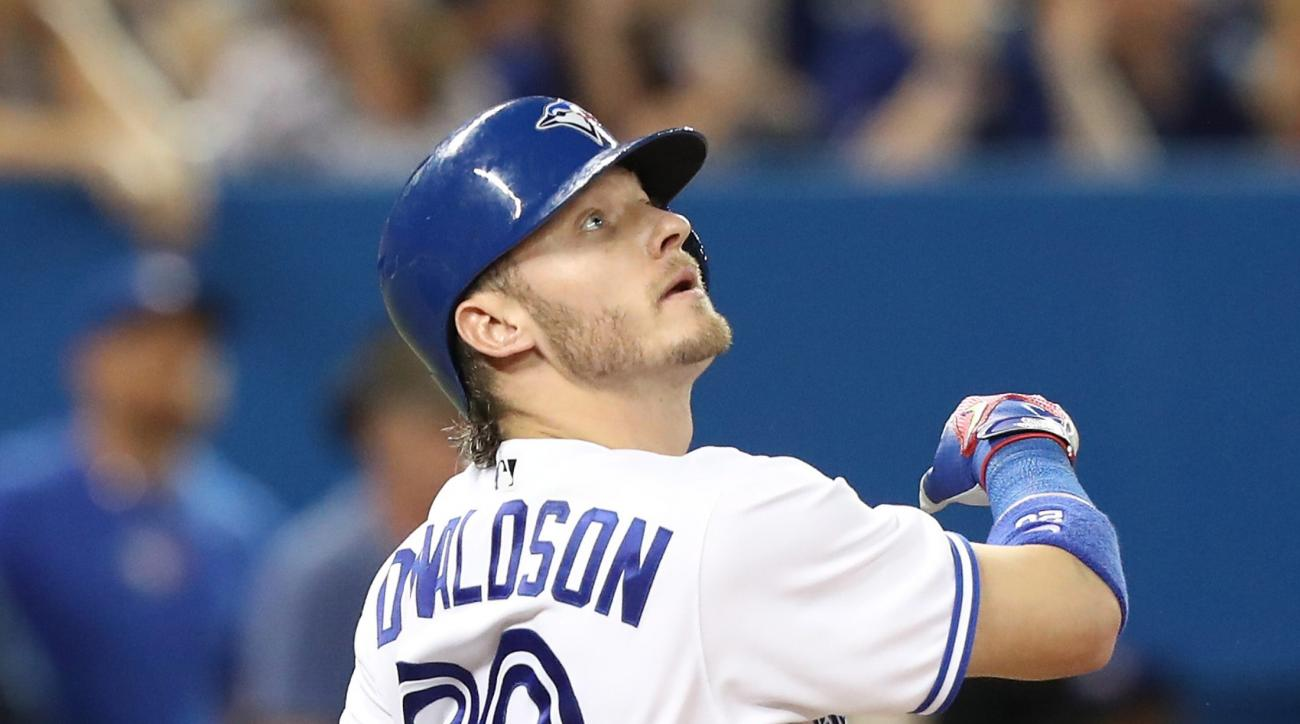 Toronto Blue Jays' Josh Donaldson watches his two-run home run leave the ballpark in the eighth inning of a baseball game against the Boston Red Sox in Toronto on Friday, May 27, 2016. (Fred Thornhill/The Canadian Press via AP) MANDATORY CREDIT