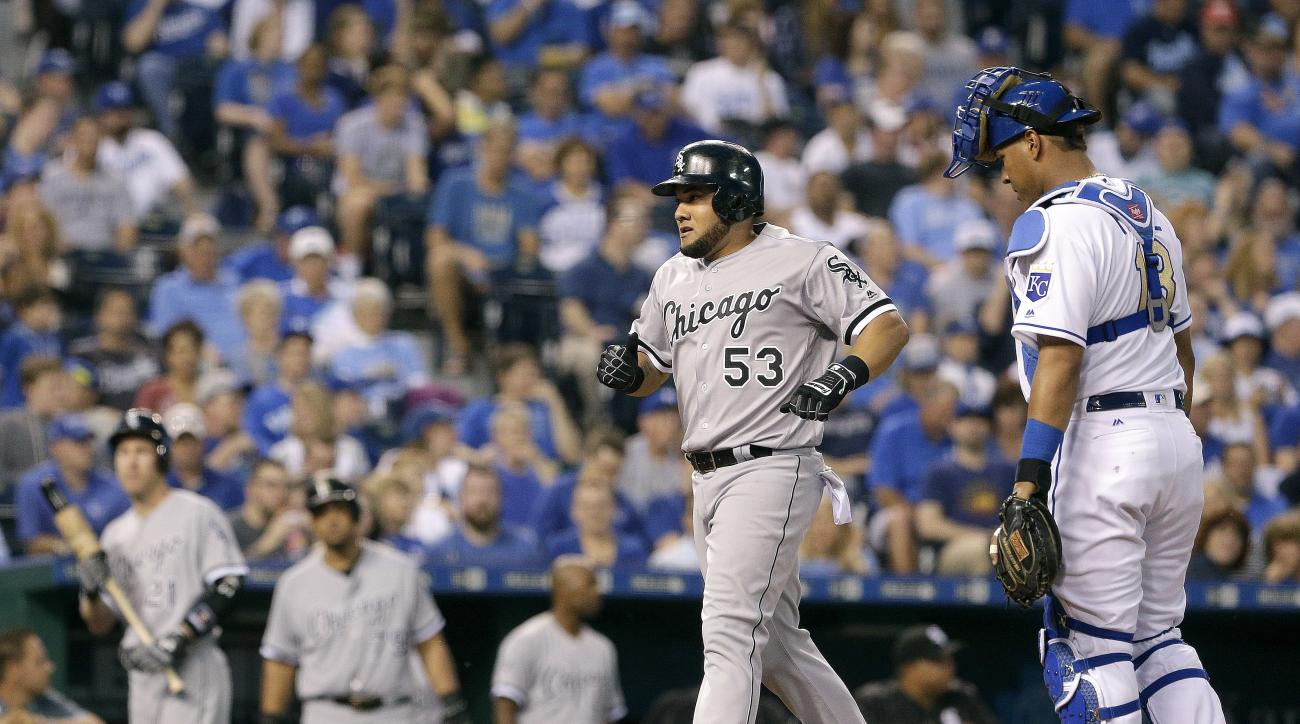 Chicago White Sox's Melky Cabrera (53) crosses the plate in front of Kansas City Royals catcher Salvador Perez after hitting a grand slam during the sixth inning of a baseball game Friday, May 27, 2016, in Kansas City, Mo. (AP Photo/Charlie Riedel)