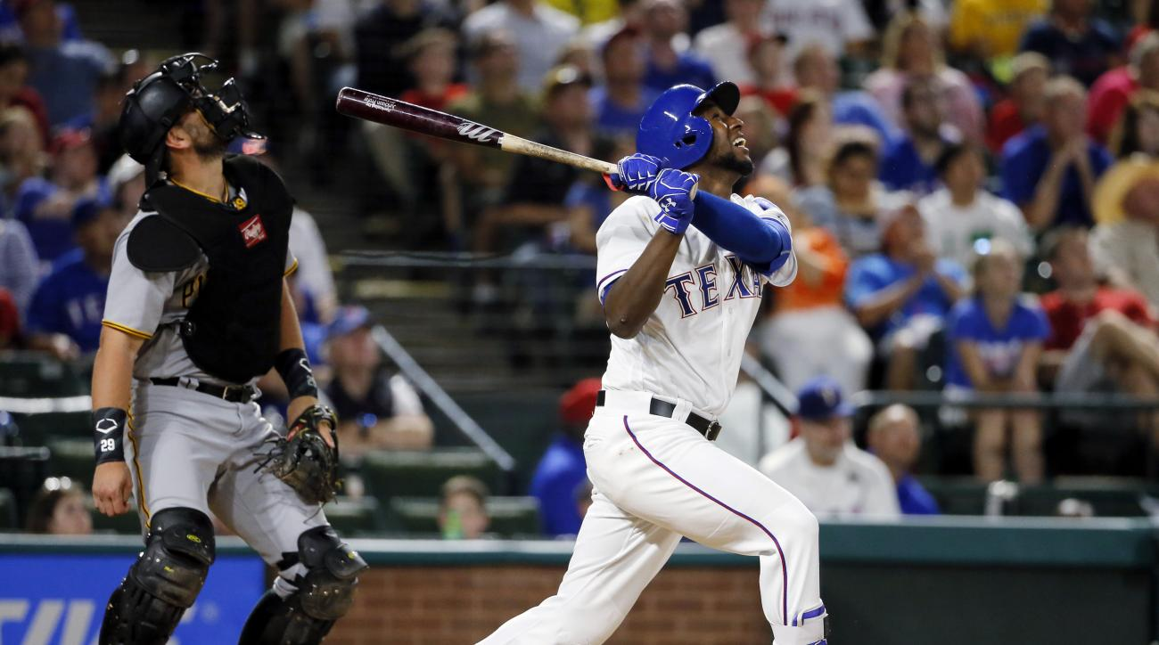 Pittsburgh Pirates catcher Francisco Cervelli and Texas Rangers Jurickson Profar watch Profar's fly out to left in the seventh inning of a baseball game, Friday, May 27, 2016, in Arlington, Texas. (AP Photo/Tony Gutierrez)