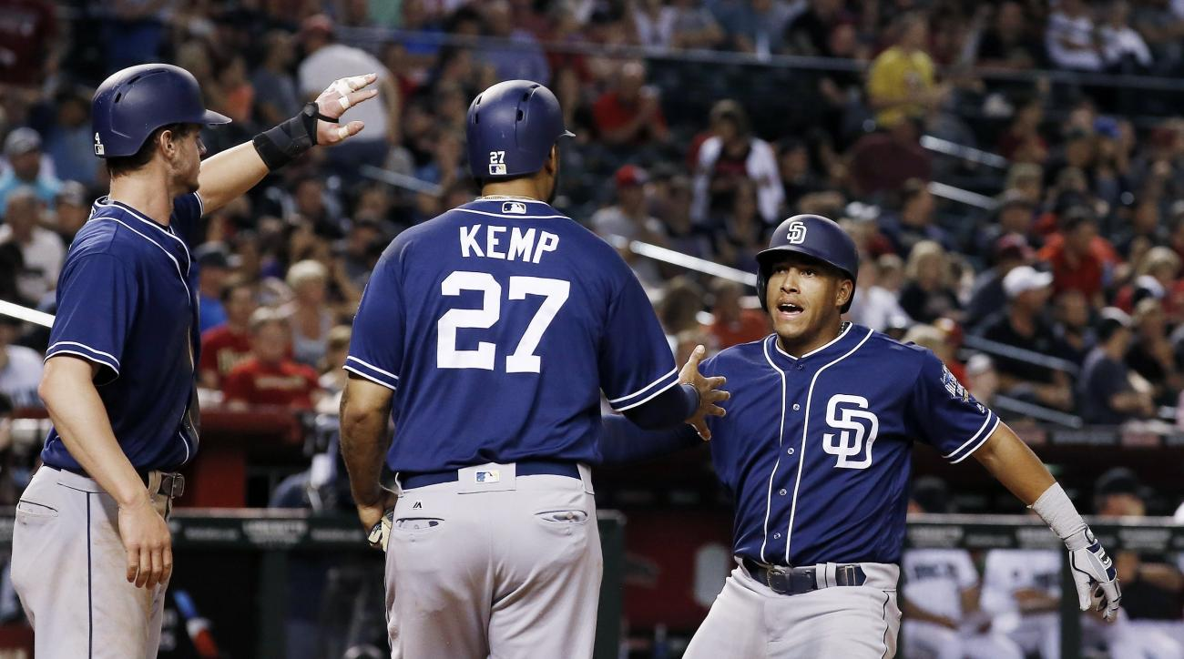 San Diego Padres' Yangervis Solarte, right, celebrates his three-run home run against the Arizona Diamondbacks with Matt Kemp (27) and Wil Myers, left, during the sixth inning of a baseball game Friday, May 27, 2016, in Phoenix. (AP Photo/Ross D. Franklin