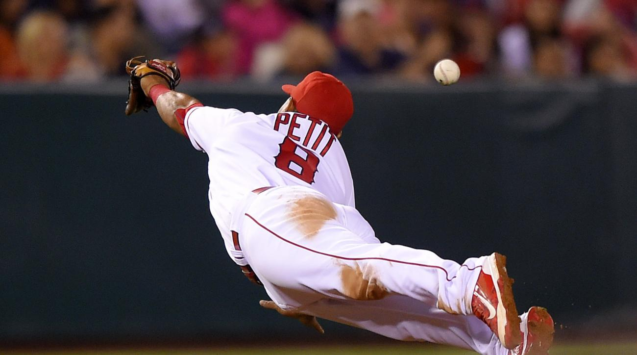 Los Angeles Angels' Gregorio Petit can't reach a ball hit for a single by Houston Astros' Evan Gattis during the seventh inning of a baseball game Friday, May 27, 2016, in Anaheim, Calif. (AP Photo/Mark J. Terrill)