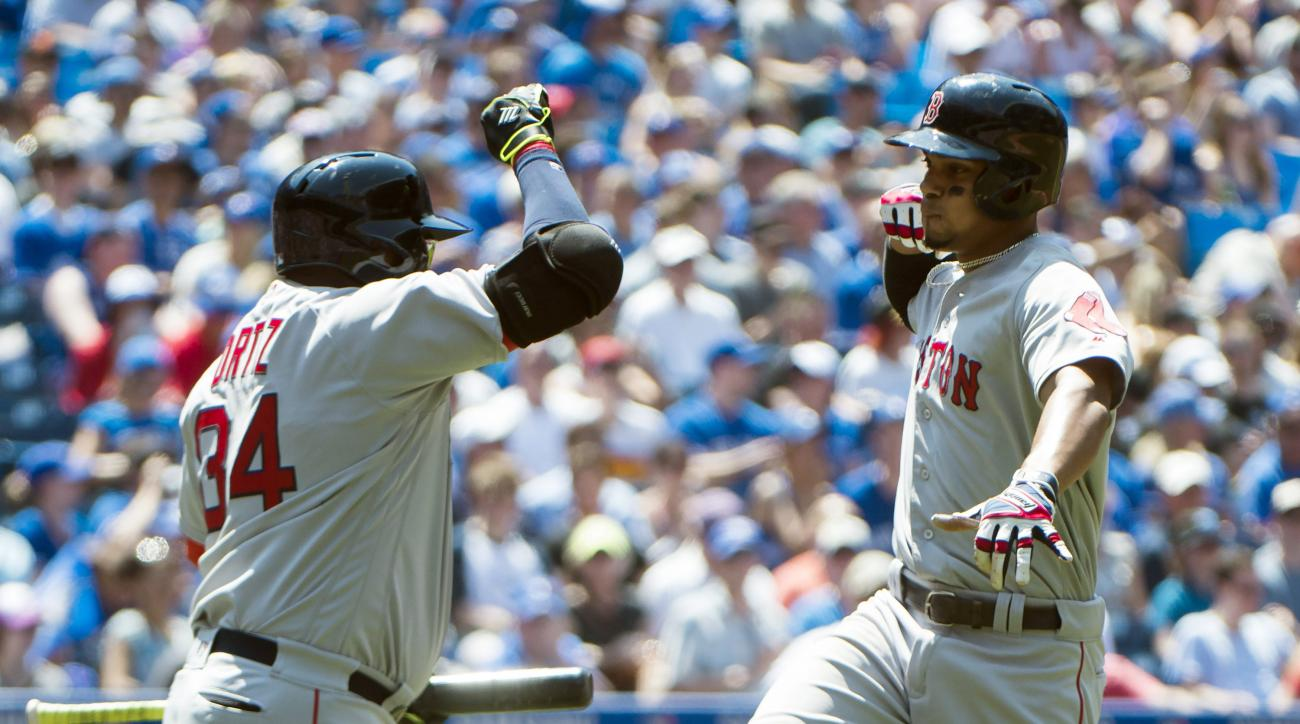 Boston Red Sox's Xander Bogaerts, right, celebrates his solo home run with David Ortiz   against the Toronto Blue Jays during the fourth inning of baseball game in Toronto, Saturday, May 28, 2016. (Nathan Denette/The Canadian Press via AP) MANDATORY CREDI