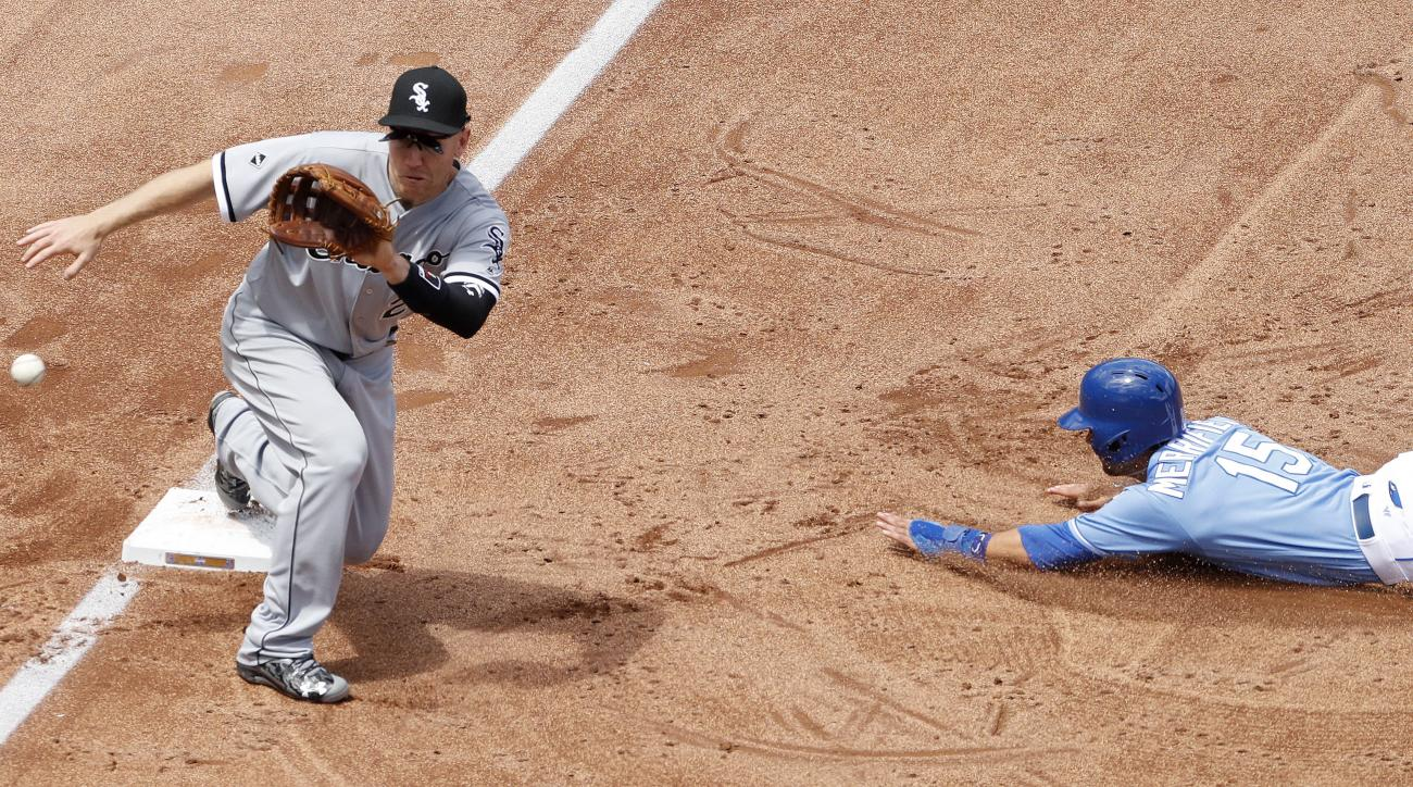Kansas City Royals' Whit Merrifield (15) beats the tag by Chicago White Sox third baseman Todd Frazier to steal third base during the third inning of a baseball game Saturday, May 28, 2016, in Kansas City, Mo. (AP Photo/Charlie Riedel)