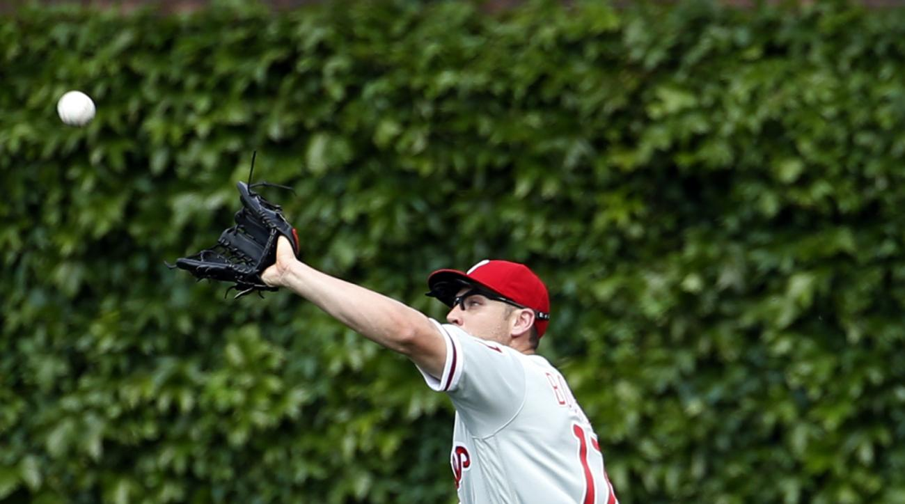 Philadelphia Phillies right fielder Peter Bourjos catches a fly ball hit by Chicago Cubs' Addison Russell during the sixth inning of a baseball game Saturday, May 28, 2016, in Chicago. (AP Photo/Nam Y. Huh)