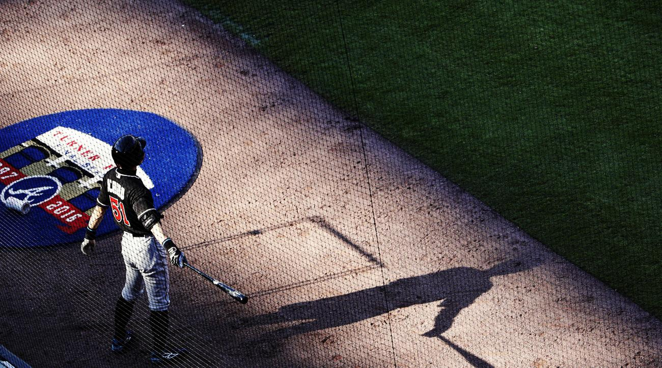 Miami Marlins' Ichiro Suzuki waits on deck to bat in the sixth inning of a baseball game against the Atlanta Braves, Saturday, May 28, 2016, in Atlanta. (AP Photo/David Goldman)