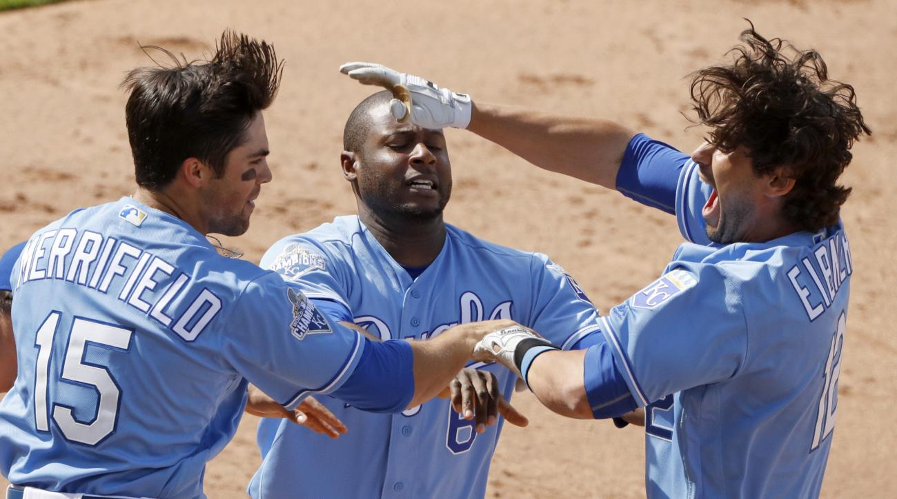 Kansas City Royals' Brett Eibner, right, celebrates with Lorenzo Cain, center, and Whit Merrifield (15) after hitting the game-winning RBI single during the ninth inning of a baseball game against the Chicago White Sox Saturday, May 28, 2016, in Kansas Ci