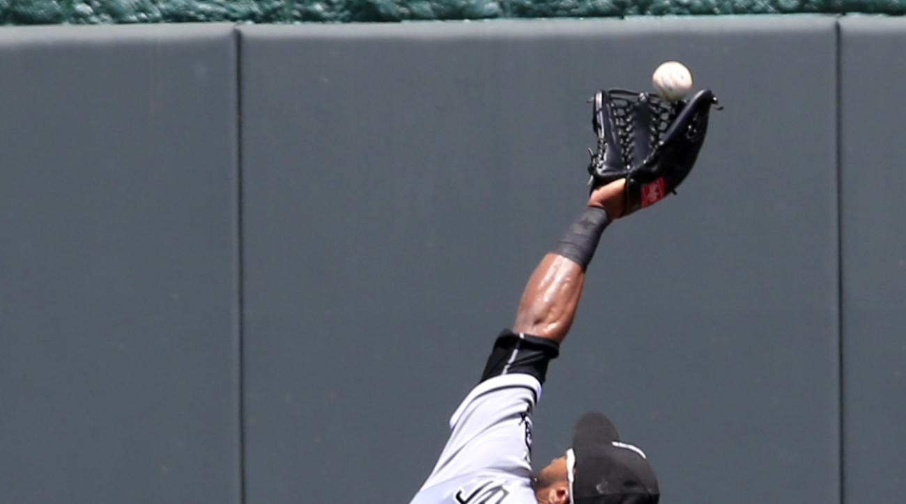Chicago White Sox center fielder Austin Jackson (10) catches a fly ball hit by Kansas City Royals designated hitter Kendrys Morales during the first inning of a baseball game at Kauffman Stadium in Kansas City, Mo., Sunday, May 29, 2016. (AP Photo/Orlin W