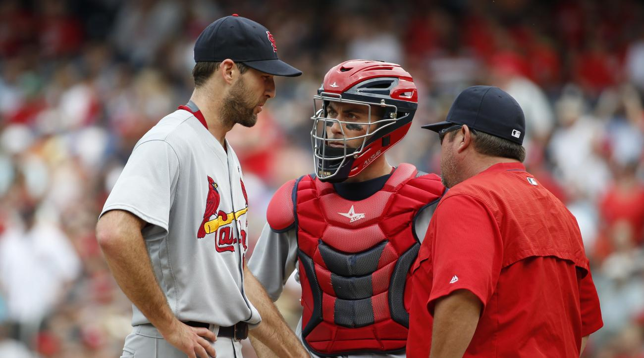 St. Louis Cardinals starting pitcher Michael Wacha, left, catcher Eric Fryer, center, and pitching coach Derek Lilliquist talk on the mound during the fourth inning of a baseball game against the Washington Nationals at Nationals Park, Sunday, May 29, 201