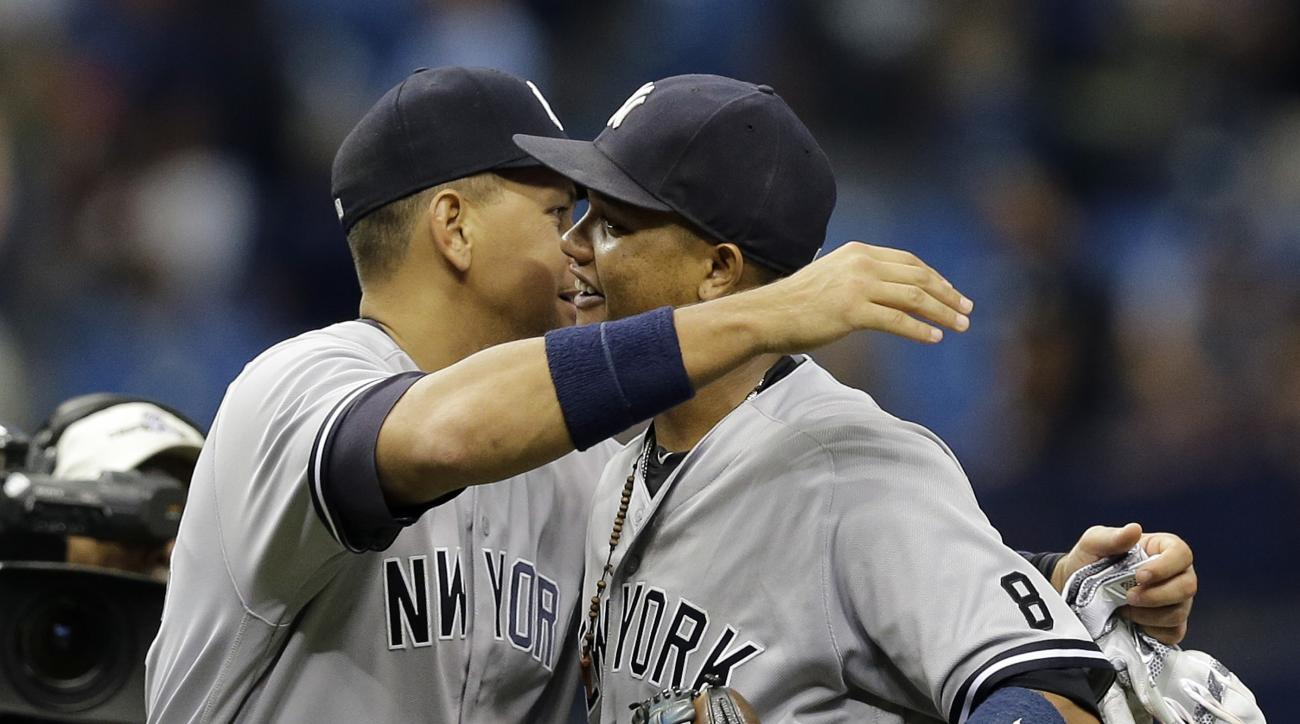 New York Yankees' Starlin Castro, right, gets a hug from Alex Rodriguez after the team defeated the Tampa Bay Rays during a baseball game Sunday, May 29, 2016, in St. Petersburg, Fla. Castro hit a two-run home run in the win. (AP Photo/Chris O'Meara)