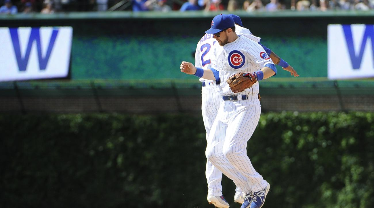 Chicago Cubs second baseman Ben Zobrist, front, and shortstop Addison Russell (27) celebrate their win over the Philadelphia Phillies in a baseball game, Sunday, May 29, 2016, in Chicago. (AP Photo/David Banks)