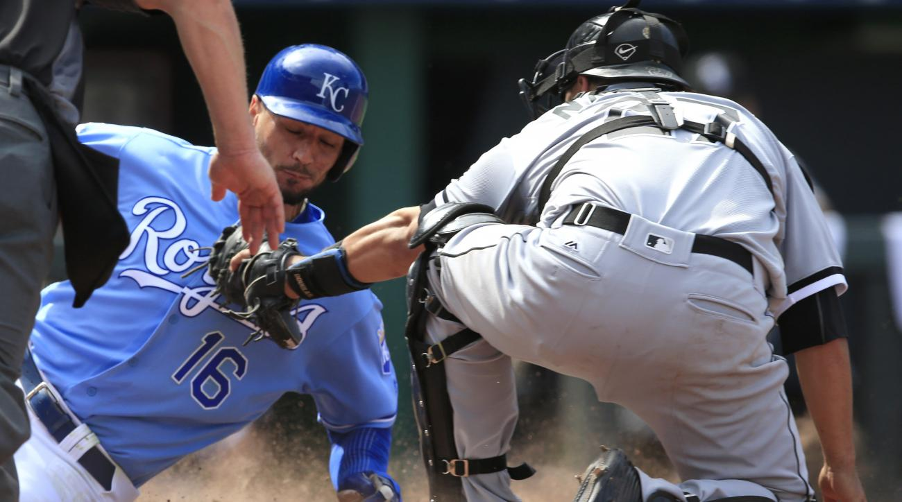 Chicago White Sox catcher Dioner Navarro (27) tags out Kansas City Royals' Paulo Orlando (16) during the eighth inning of a baseball game at Kauffman Stadium in Kansas City, Mo., Sunday, May 29, 2016. The Royals defeated the White Sox 5-4. (AP Photo/Orlin