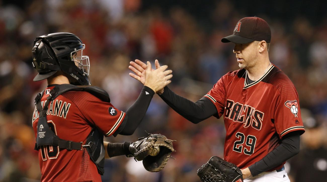 Arizona Diamondbacks catcher Chris Herrmann, left, and Brad Ziegler celebrate after defeating the San Diego Padres in a baseball game, Sunday, May 29, 2016, in Phoenix. (AP Photo/Rick Scuteri)