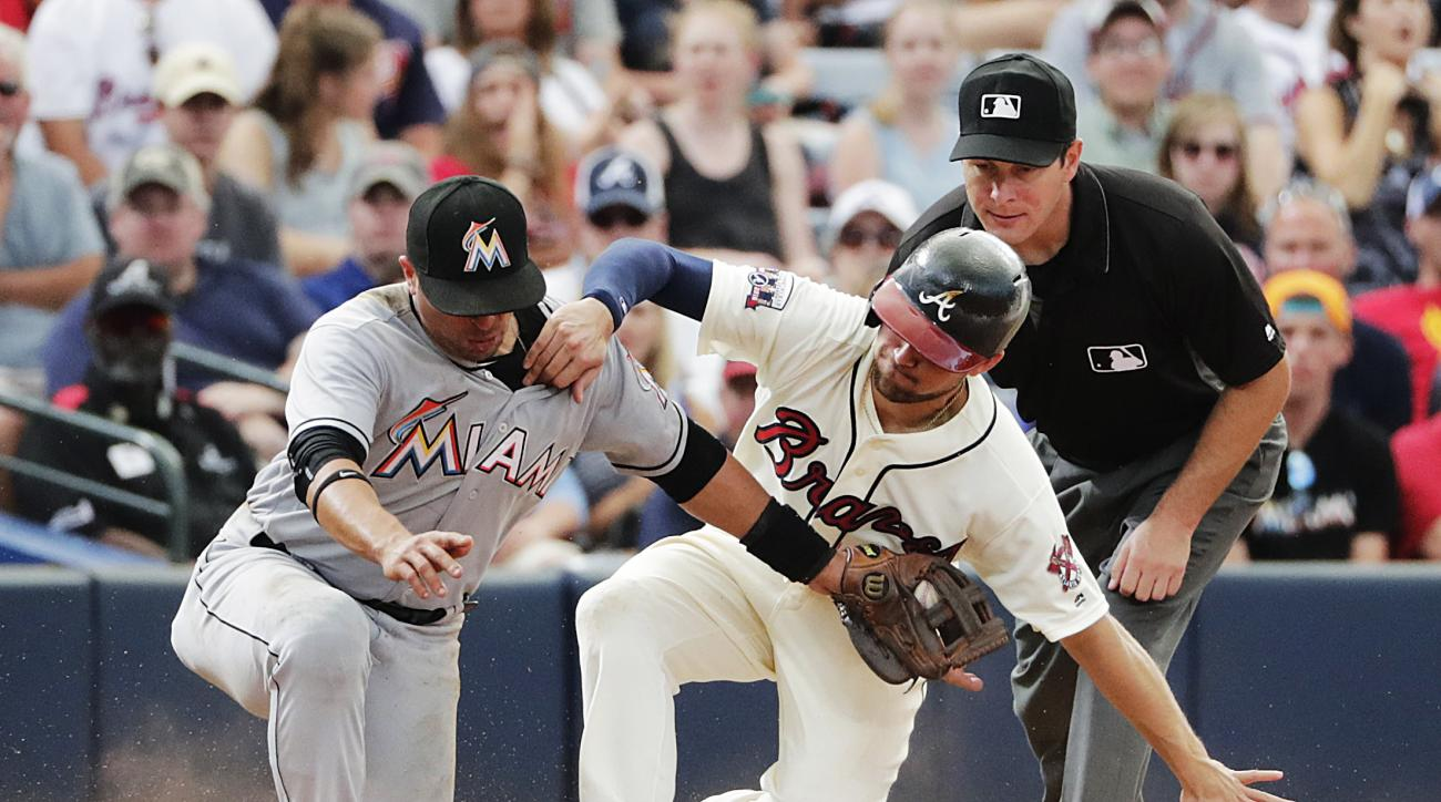 Atlanta Braves' Ender Inciarte, right, beats the tag by Miami Marlins' Martin Prado to steal third base in the eighth inning of a baseball game Sunday, May 29, 2016, in Atlanta. (AP Photo/David Goldman)