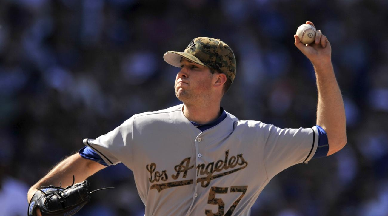 Los Angeles Dodgers starter Alex Wood delivers a pitch during the first inning of a baseball game against the Chicago Cubs on Monday, May 30, 2016, in Chicago. (AP Photo/Paul Beaty)