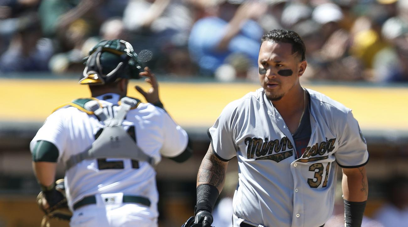 Minnesota Twins' Oswaldo Arcia reacts after striking out against the Oakland Athletics in the eighth inning of a baseball game Monday, May 30, 2016, in Oakland, Calif. Oakland won 3-2. (AP Photo/Tony Avelar)