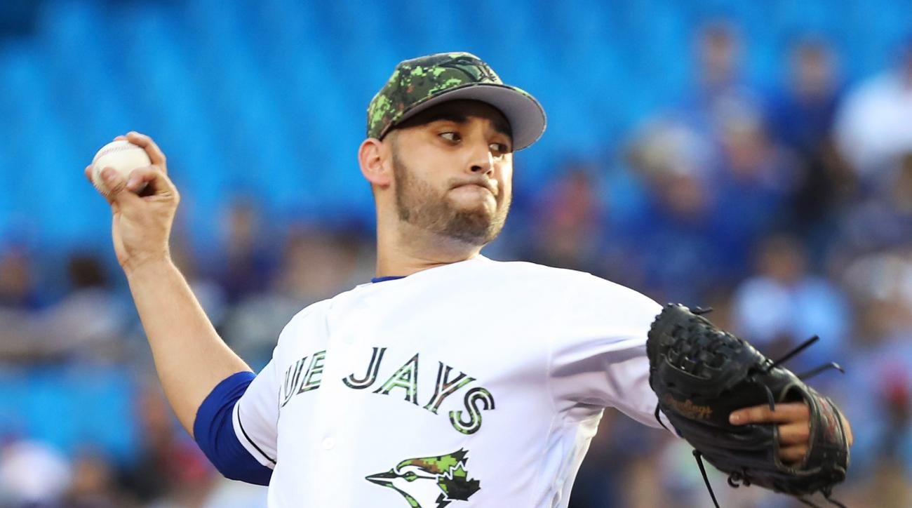 Toronto Blue Jays starting pitcher Marco Estrada throws against the New York Yankees during the first inning of a baseball game in Toronto on Monday, May 30, 2016. (Fred Thornhill/The Canadian Press via AP) MANDATORY CREDIT