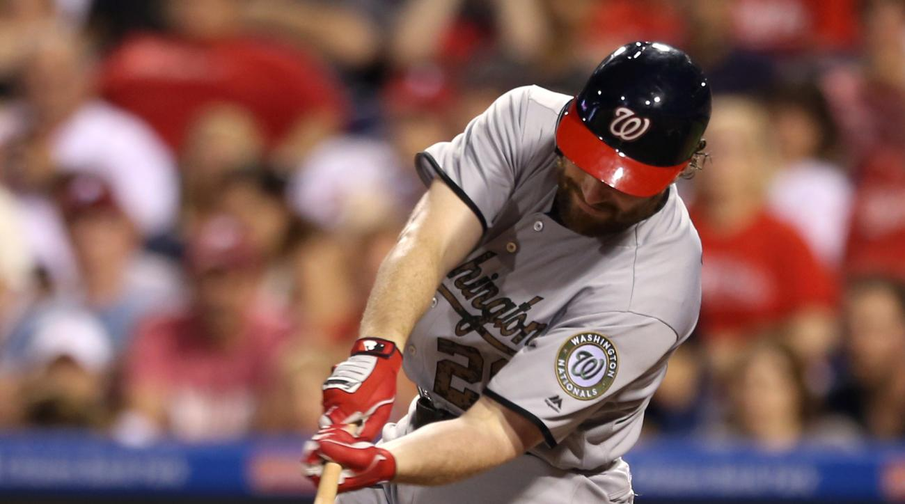 Washington Nationals' Daniel Murphy (20) hits an RBI-single on Philadelphia Phillies pitcher Hector Neris allowing Ben Revere and Jayson Werth to score in the eighth inning of a baseball game Monday, May 30, 2016, in Philadelphia. The Nationals won 4-3. (