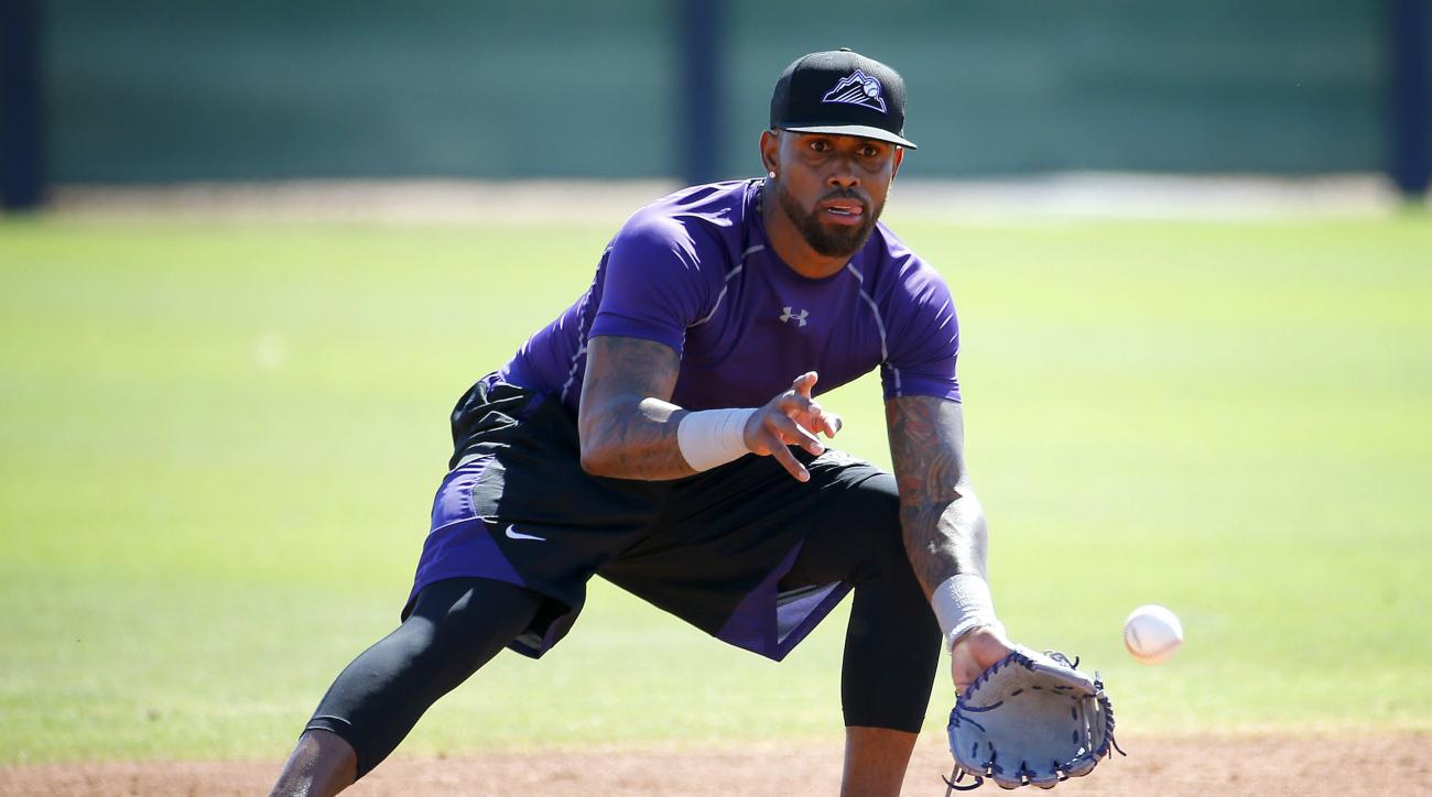 FILE - In this May 19, 2016, file photo, Colorado Rockies' Jose Reyes runs drills during an extended spring training at the Rockies' facility in Scottsdale, Ariz. Rockies manager Walt Weiss says Reyes will report to Triple-A Albuquerque for an injury reha