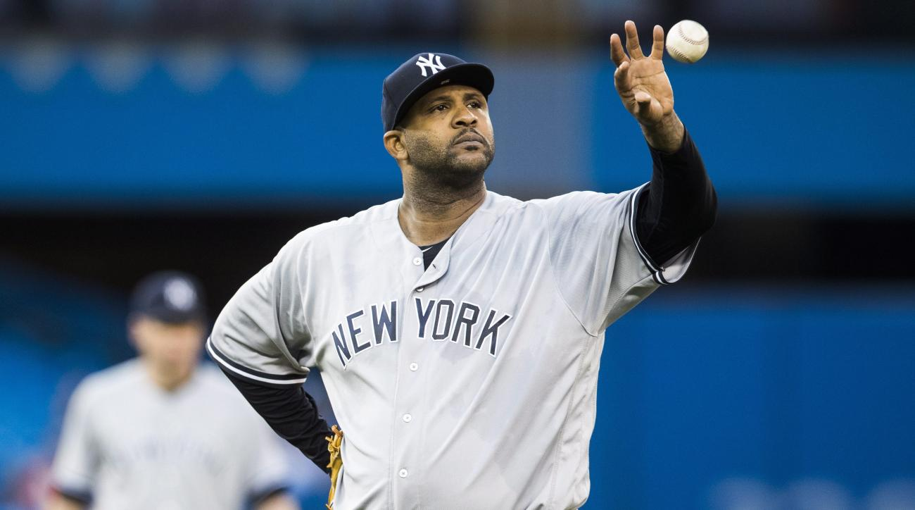 New York Yankees piticher CC Sabathia catches the ball during the fourth inning of the team's baseball game against the Toronto Blue Jays on Tuesday, May 31, 2016, in Toronto. (Mark Blinch/The Canadian Press via AP)