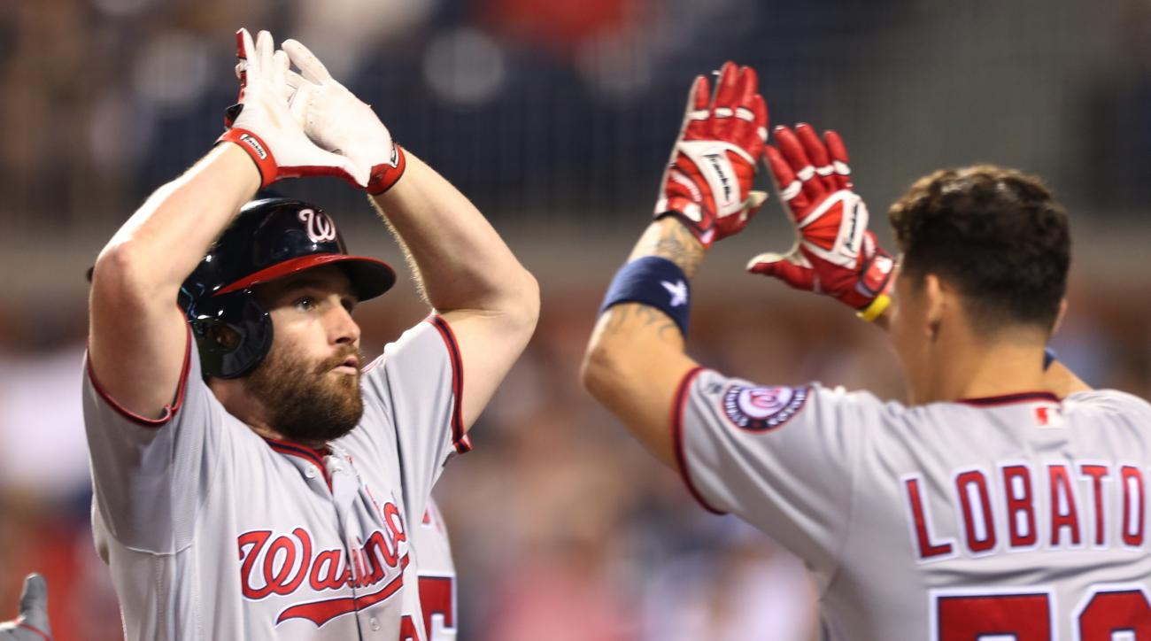 Washington Nationals' Daniel Murphy, left, high-fives Jose Lobaton (59) after hitting a home run off Philadelphia Phillies starting pitcher Aaron Nola during the sixth inning of a baseball game, Tuesday, May 31, 2016, in Philadelphia. The Nationals won 5-