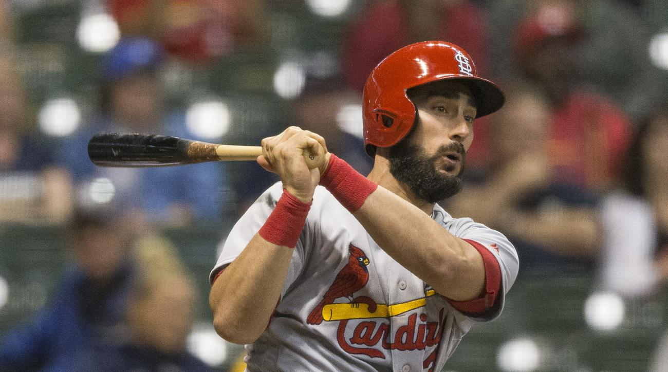 St. Louis Cardinals' Matt Carpenter follows through on a his fourth hit of the game and second triple off of Milwaukee Brewers' Jahn Mariez during the eighth inning of a baseball game Tuesday, May 31, 2016, in Milwaukee. (AP Photo/Tom Lynn)