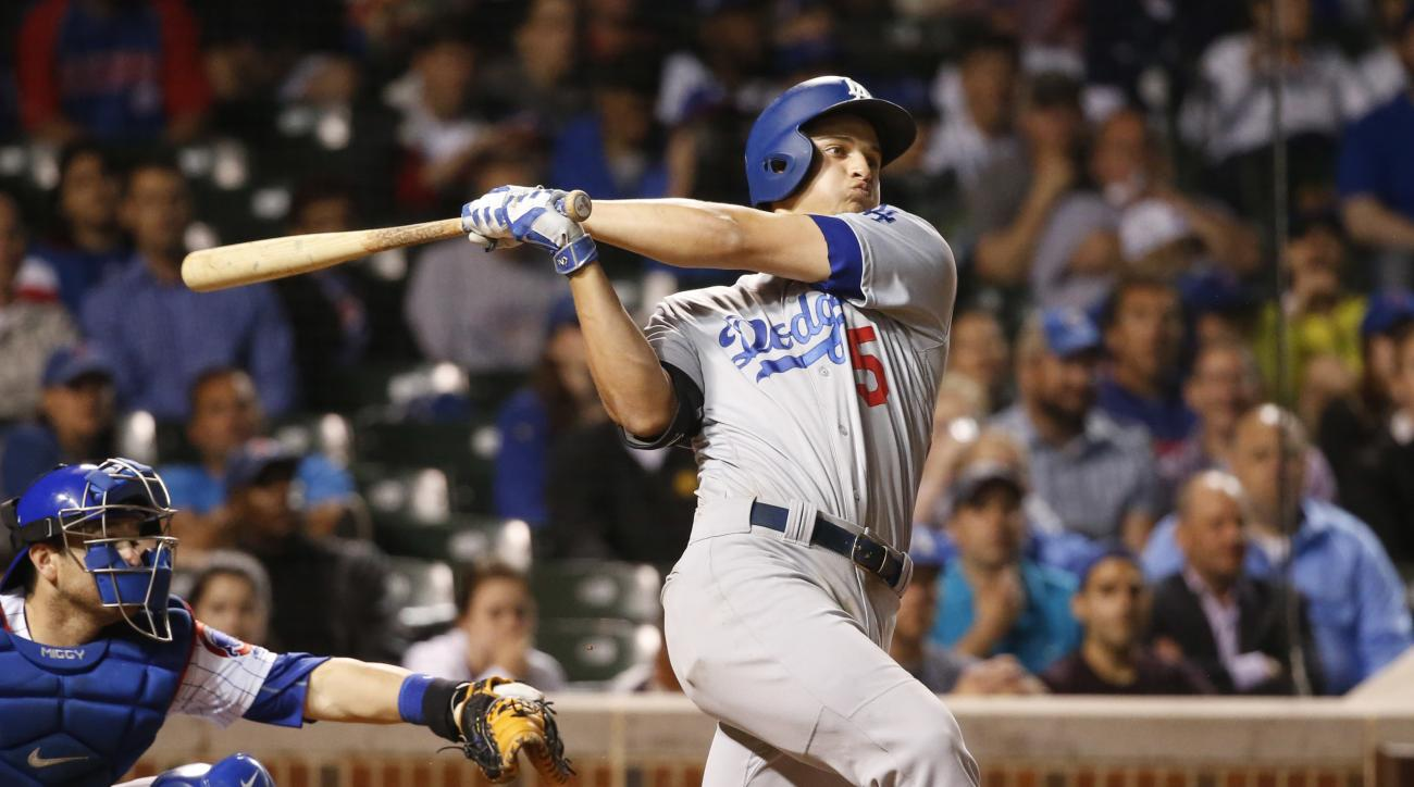 Los Angeles Dodgers' Corey Seager watches his three-run home run off Chicago Cubs relief pitcher Trevor Cahill during the ninth inning of the Dodgers' 5-0 win in a baseball game Tuesday, May 31, 2016, in Chicago. (AP Photo/Charles Rex Arbogast)