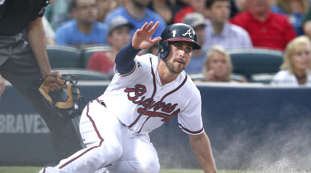 Atlanta Braves Ender Inciarte scores as he slides into home plate during the fourth inning of a baseball game against the San Francisco Giants, Wednesday, June 1, 2016, in Atlanta. (AP Photo/Butch Dill)