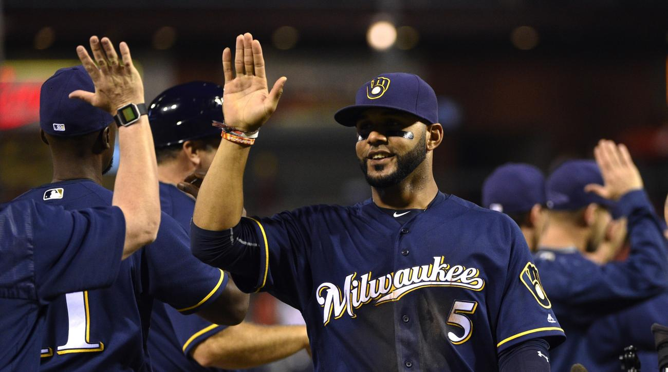 Milwaukee Brewers' Jonathan Villar high-fives teammates after a 4-1 victory against the Philadelphia Phillies in a baseball game Thursday, June 2, 2016, in Philadelphia. (AP Photo/Derik Hamilton)