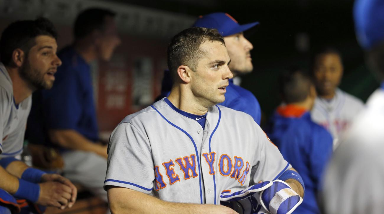 FILE - In this May 23, 2016, file photo, New York Mets' David Wright pauses in the dugout after hitting a three-run homer during the third inning of a baseball game against the Washington Nationals at Nationals Park in Washington. Wright has been placed o
