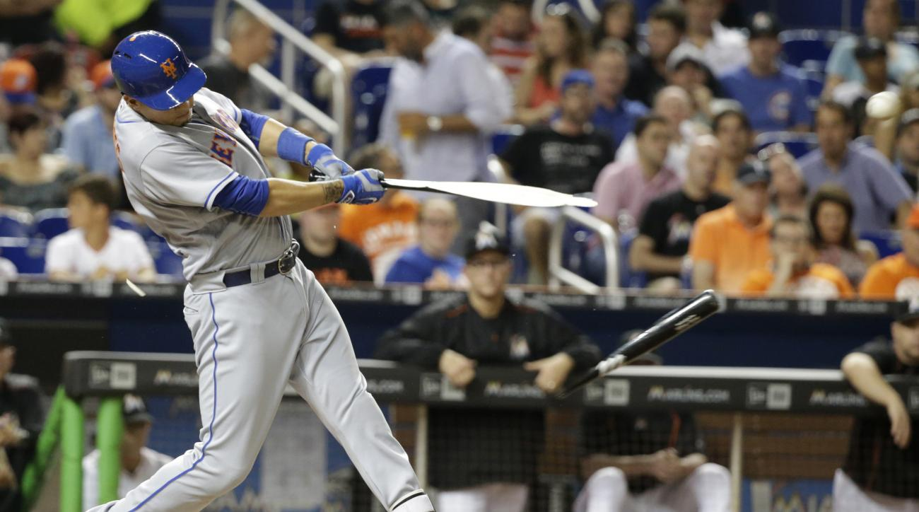 New York Mets' Wilmer Flores breaks his bat as he hits a single scoring Yoenis Cespedes during the fourth inning of a baseball game against the Miami Marlins, Friday, June 3, 2016, in Miami. (AP Photo/Wilfredo Lee)