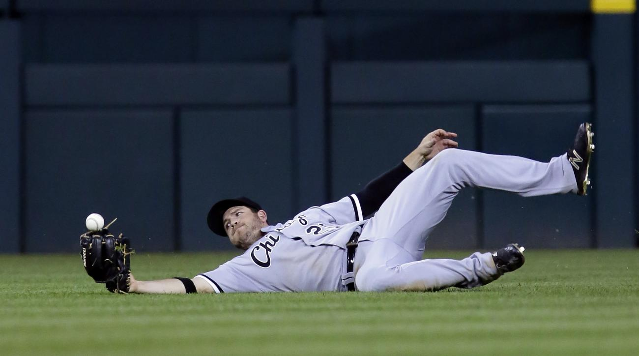 Chicago White Sox center fielder J.B. Shuck can't hang on to the fly ball hit by Detroit Tigers' James McCann for a single during the sixth inning of a baseball game Friday, June 3, 2016, in Detroit. Detroit's J.D. Martinez scored on the single but Shuck