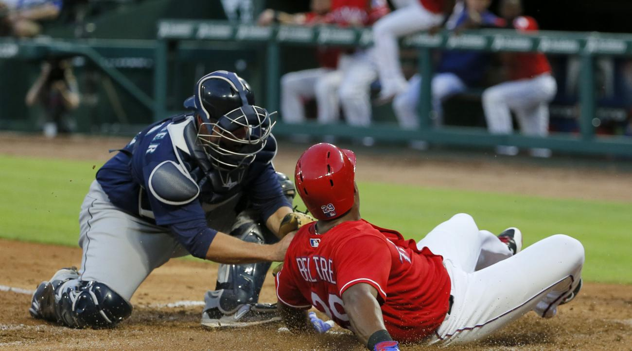 Seattle Mariners catcher Steve Clevenger (32) tags out Texas Rangers' Adrian Beltre who was trying to score from second on a Ryan Rua single in the third inning of a baseball game on, Friday, June 3, 2016, in Arlington, Texas. (AP Photo/Tony Gutierrez)