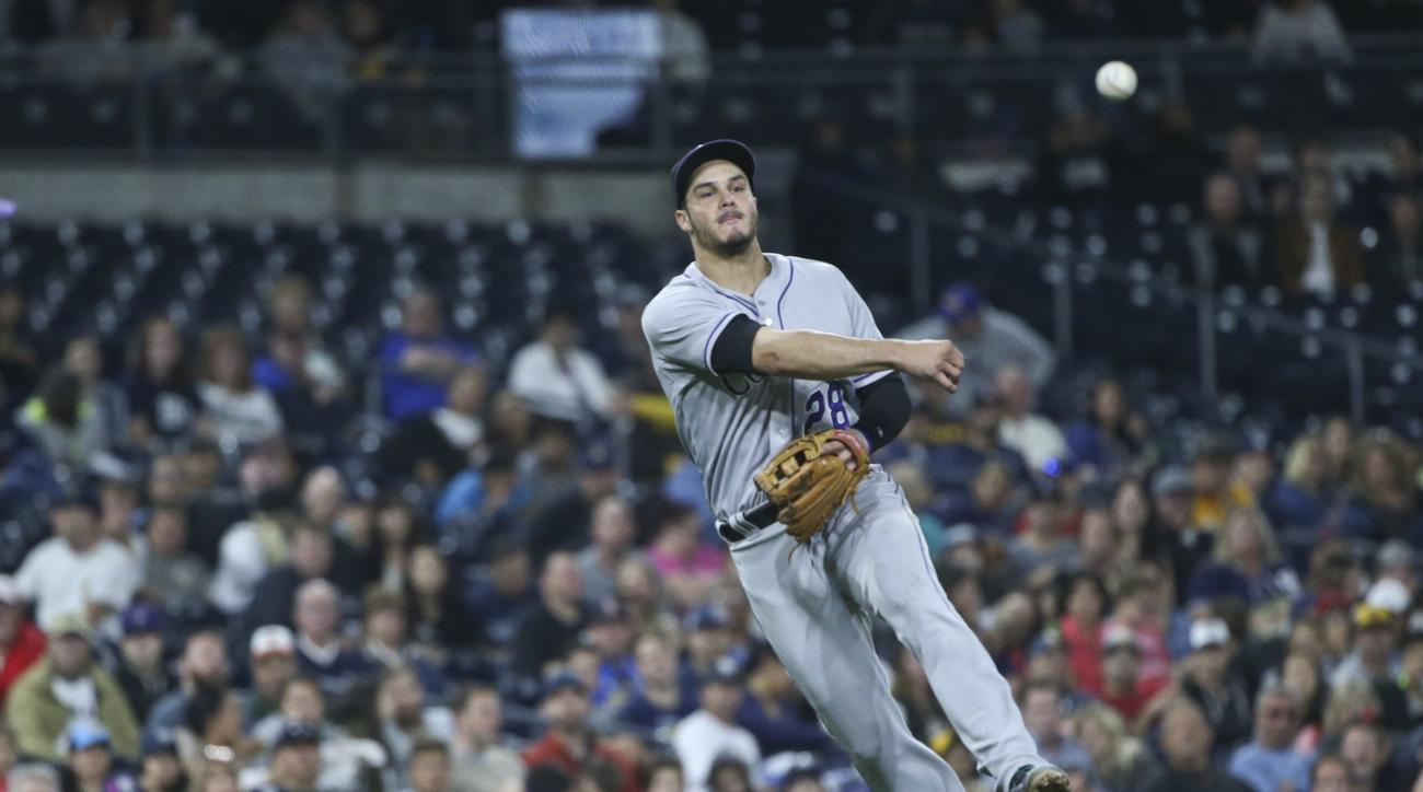 Colorado Rockies third baseman Nolan Arenado throws out San Diego Padres' Alexei Ramirez at first base after fielding a slow roller behind the pitcher's mound in the sixth inning of a baseball game Friday, June 3, 2016, in San Diego. (AP Photo/Lenny Ignel