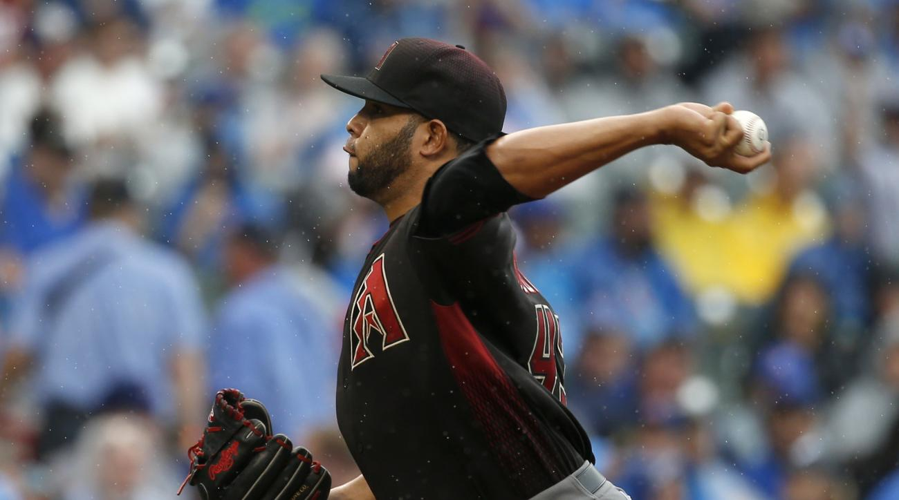 Arizona Diamondbacks starter Edwin Escobar throws against the Chicago Cubs during the first inning of a baseball game Saturday, June 4, 2016, in Chicago. (AP Photo/Nam Y. Huh)